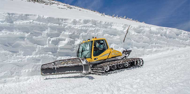 Snowcat working to clear the craigway snow drift on Mount Washington